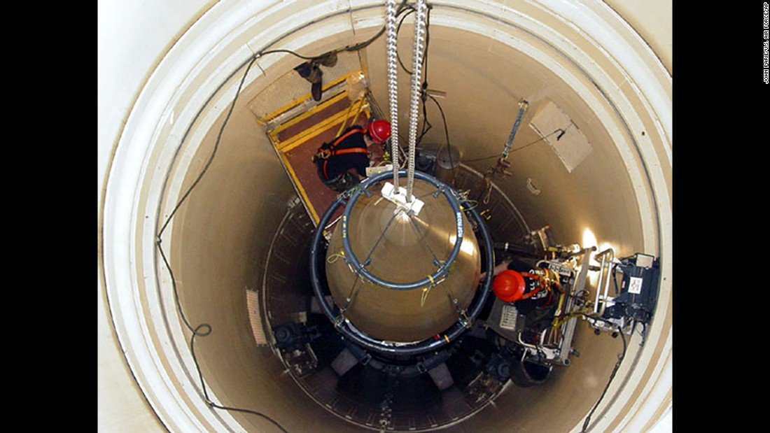"In this undated image released by the U.S. Air Force, a maintenance team from Montana's Malmstrom Air Force Base removes the upper section of an intercontinental ballistic missile. Missile launch officers at the base's Global Strike Command were recently caught <a href=""http://www.cnn.com/2014/03/27/us/air-force-cheating-investigation/"" target=""_blank"">cheating on proficiency exams.</a>"