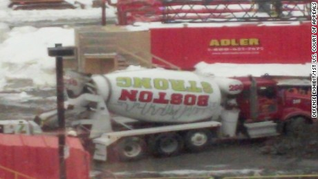 "The defense says ""Boston Strong"" slogans are easy to find in the city, including on this cement mixer."