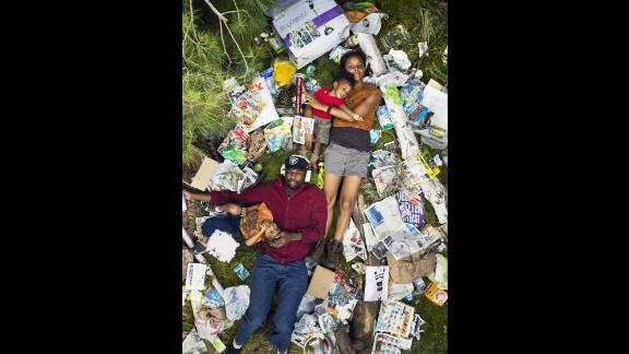 "Elias, Jessica, Azai and Ri-Karlo pose for photographer Gregg Segal's ""7 Days of Garbage"" series."
