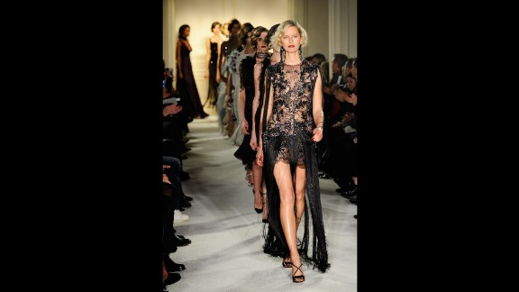 """Model Karolina Kurkova, with """"Gatsby"""" hair and a fringe-accented gown, leads the final walk in the Marchesa show."""