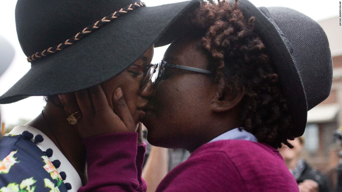 Tori Sisson, left, and Shanté Wolfe kiss after saying their marriage vows in Montgomery, Alabama, on Monday, February 9.
