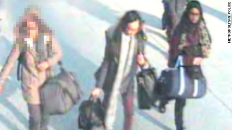 UK police say this image shows 16-year-old Kadiza Sultana, center, and 15-year-old Shamima Begum, right, at London Gatwick Airport on Tuesday.