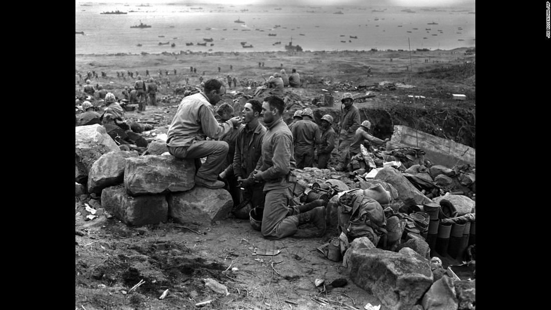U.S. Marines receive communion from a Marine chaplain on March 3, 1945.