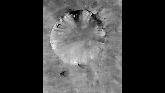 This is Vesta's Numisia crater. It's about 19 miles (31 kilometers) in diameter.