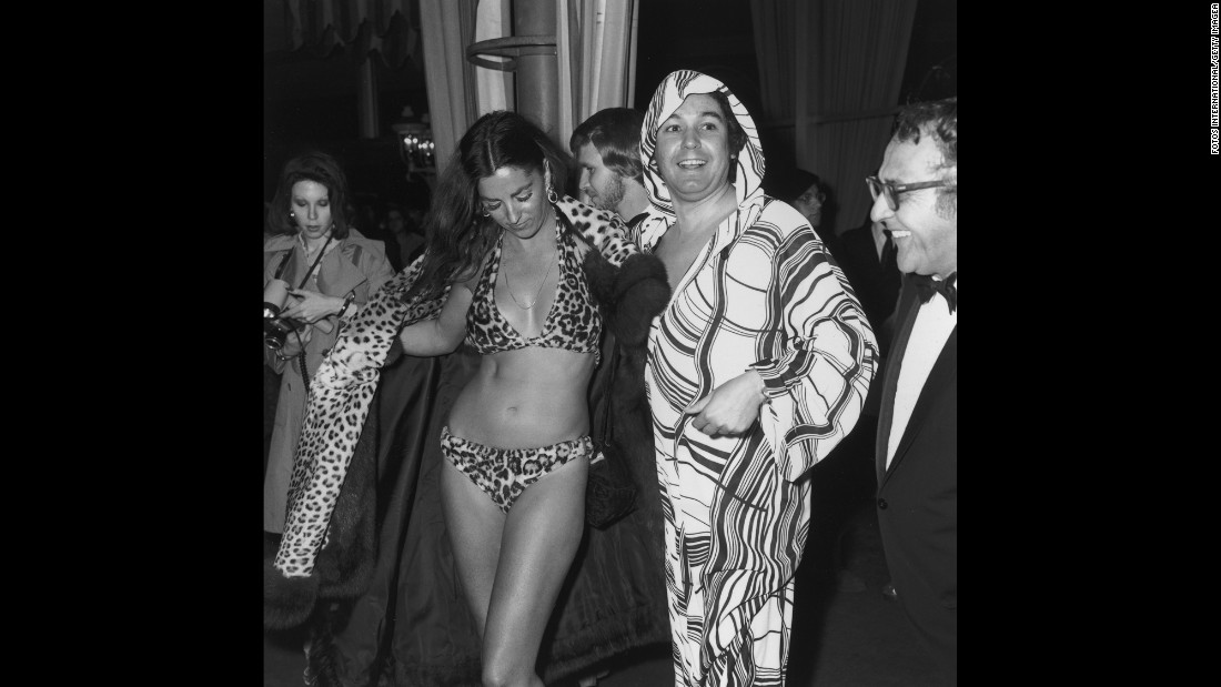 Edy Williams opens her leopard fur coat to reveal a leopard fur bikini at the Academy Awards at the L.A. County Music Center in 1974.