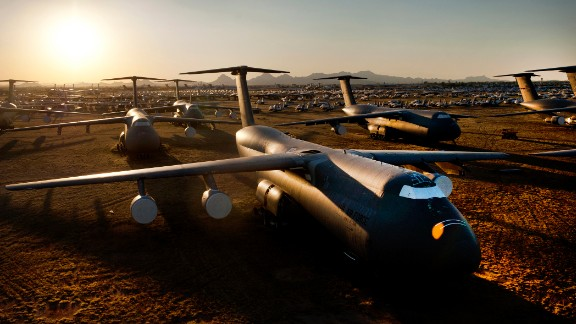 A C-5 Galaxy and other planes glitter in the light of the setting sun at the Boneyard. Thousands of aircraft are stored at the sprawling Air Force facility outside Tucson, where the dry desert air helps preserve them. Some planes are scavenged to supply parts to their counterparts still in the fleet, while others are restored or upgraded to be returned to service.