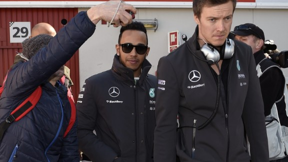 World champion Lewis Hamilton was the subject of close media scrutiny as he arrived for afternoon testing in Barcelona.  Hamilton had to cut short his track time Thursday because he was feeling unwell but impressed in his Friday runs.