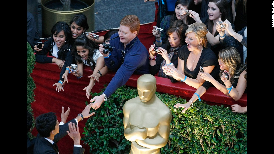 Fans reach out to actor Dev Patel as he arrives at the Academy Awards at the Kodak Theater in Los Angeles in February 2009.