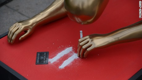 Artist 'Plastic Jesus' showcased a life-size Oscar-inspired statue snorting what looks like cocaine.