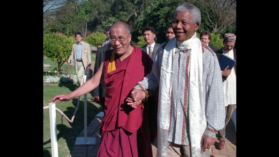 In 1996, the Dalai Lama meets with Nelson Mandela, the prisoner-turned president who reconciled South Africa after the end of apartheid.