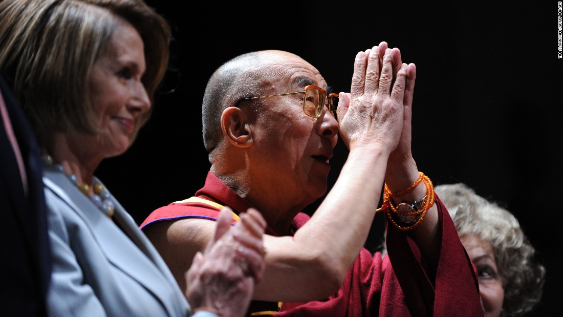 U.S. House of Representatives Speaker Nancy Pelosi awards the inaugural Lantos Human Rights Prize to the Dalai Lama in October 2009, honoring his commitment to ending global injustices.