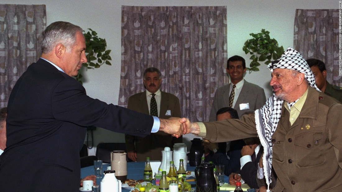 Netanyahu meets with Palestinian leader Yasser Arafat for the first time on September 4, 1996, at an Israeli army base at the Erez Checkpoint in Gaza.