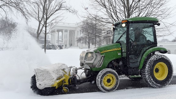 Snow is cleared on the North side of the White House in Washington, Saturday, February 21.