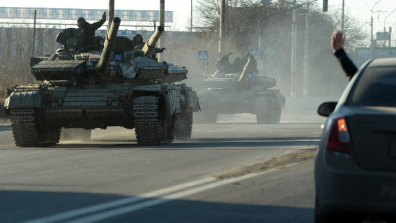 Pro-Russian separatists ride tanks in the eastern Ukrainian city of Lugansk on February 21, 2015. Ukraine