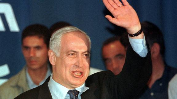 Netanyahu thanks a crowd of supporters in Tel Aviv, Israel, at a Likud party meeting in May 1999. The outgoing Prime Minister announced that he was quitting the Knesset and stepping down as party leader 10 days after being defeated in elections.
