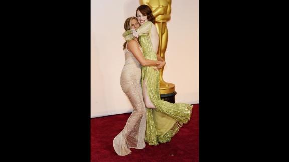 Jennifer Aniston, left, and Emma Stone