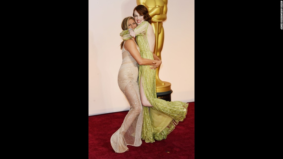 Jennifer Aniston, left, and Emma Stone