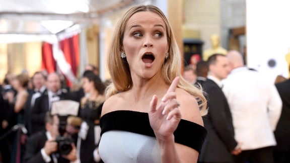 "Reese Witherspoon arrives at the 87th Academy Awards in Hollywood. She is one of several celebs calling for more substance to red carpet interviews beyond ""Who are you wearing?"" - prompting the social media hashtag #AskHerMore. Click through the gallery for more from the 2015 Oscars."