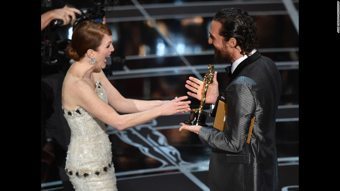 "Matthew McConaughey presents Julianne Moore with the Oscar at the 87th Academy Awards. She won for her role in ""Still Alice."""