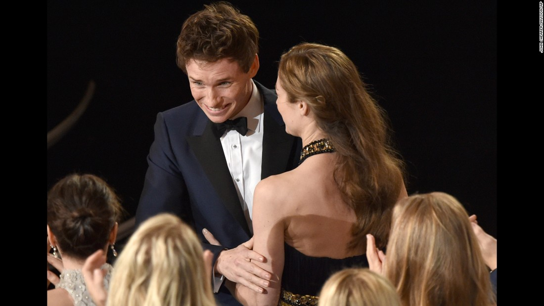 "Eddie Redmayne is congratulated after winning best actor for his performance as Stephen Hawking in ""The Theory of Everything."""