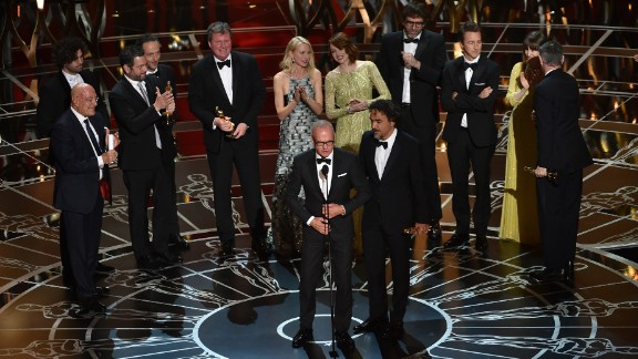 "Michael Keaton, front left, and ""Birdman"" director Alejandro Gonzalez Iñarritu accept the Academy Award for best picture along with other members of the film's cast and crew. ""Birdman"" also won three other Oscars: best director, best cinematography and best original screenplay."