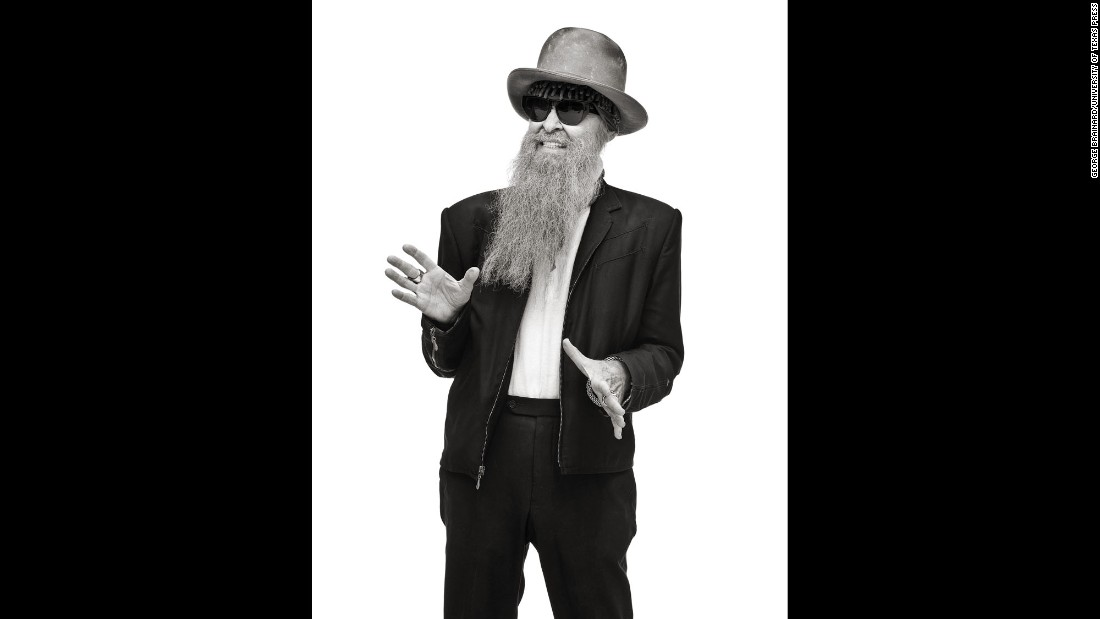 "Every year car enthusiasts from around the country attend vintage car shows hosted by The Kontinentals, a car club based in Austin, Texas. Here, Billy Gibbons of ZZ Top poses for photographer George Brainard's camera. Gibbons also wrote the introduction to Brainard's new book, ""All Tore Up."""
