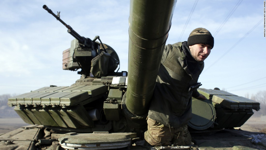 A Ukrainian serviceman climbs out of a Ukrainian army tank at a checkpoint near Horlivka, in the region of Donetsk, on February 23, 2015.