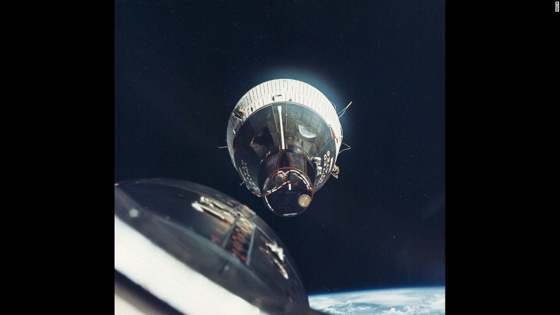 Traveling at 17,000 mph, the Gemini 6 crew flies to within inches of the orbiting Gemini 7 spacecraft in December 1965. It was the first rendezvous in space.