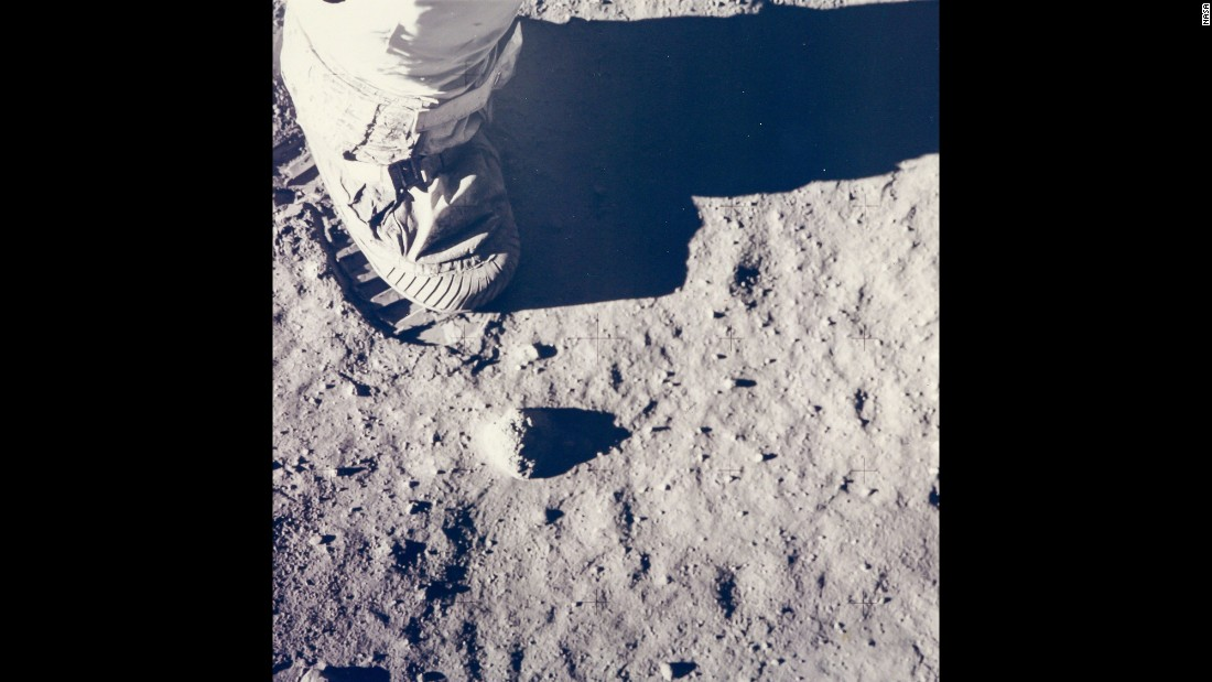 "This now famous image of Aldrin's boot was taken to provide a visual record of the relative density of the moon's surface. ""I felt buoyant and full of goose pimples when I stepped down on the surface,"" Aldrin said. ""I immediately looked down at my feet and became intrigued with the peculiar properties of the lunar dust."""