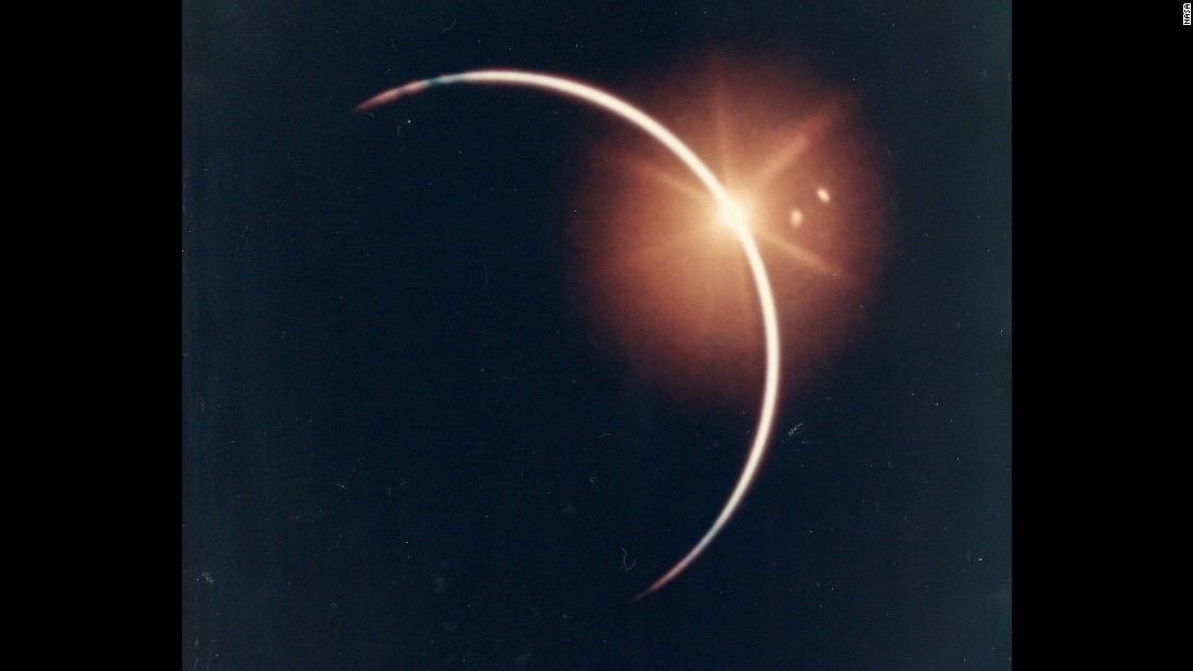 "This dramatic view shows an eclipse that occurred when the Earth moved between the sun and the Apollo 12 spacecraft in November 1969. It's a scene that can only be seen from space. ""When the Earth completed eclipsing the sun, you could see a big white light right in the middle of the Earth moving across the ocean. We didn't know what that was,"" astronaut Alan Bean said. ""When we got back, Rusty Schweickart pointed out that it was the moon right behind us reflecting off the Earth."""