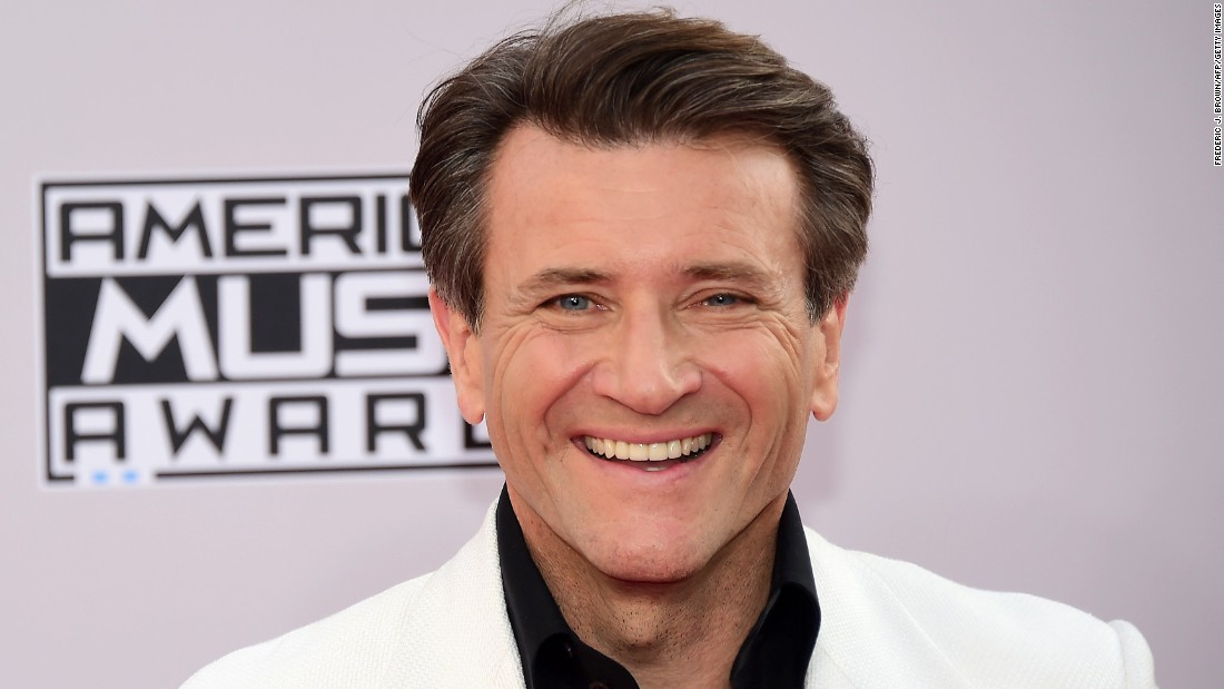 "Entrepreneur and ""Shark Tank"" panelist Robert Herjavec got kicked of the show but may have won in another realm: He's reportedly dating his partner, pro dancer Kym Johnson."