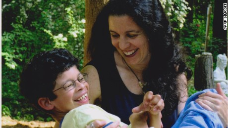 Carrie McGee and her son, Alex. When Alex was diagnosed with Williams syndrome, she quit her job to care for him.