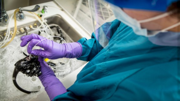 """A technician cleans a duodenoscope. The FDA issued advice to hospitals to follow manufacturer's instructions and also """"meticulously"""" clean by hand a part of the scope that may harbor bacteria that is hard to get at, after reports that the scopes were spreading superbugs from patient to patient in several medical facilities around the country."""