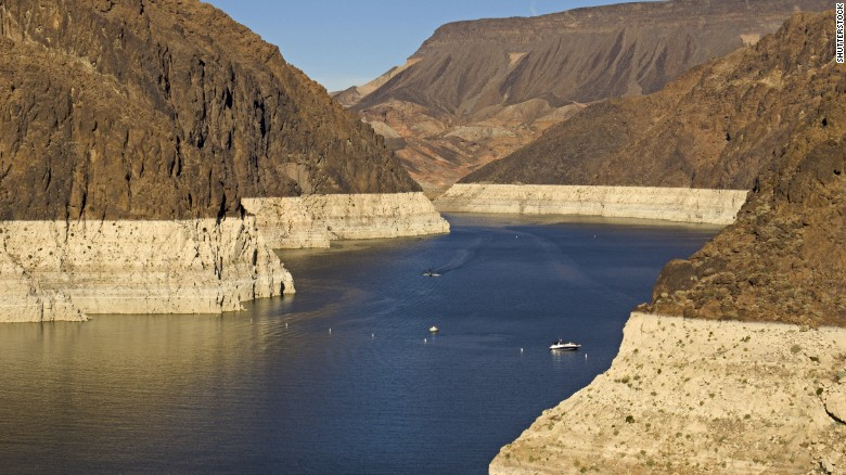 """As water drains from Lake Mead, a """"bathtub ring"""" of minerals is left on the shore, showing its decline. The height of the ring in June was roughly the size of the Statue of Liberty without its base."""