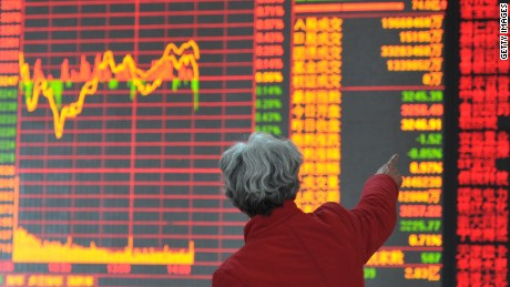 Share holders look at a security trading floor on February 25, 2015 in Shenyang, Liaoning province of China.