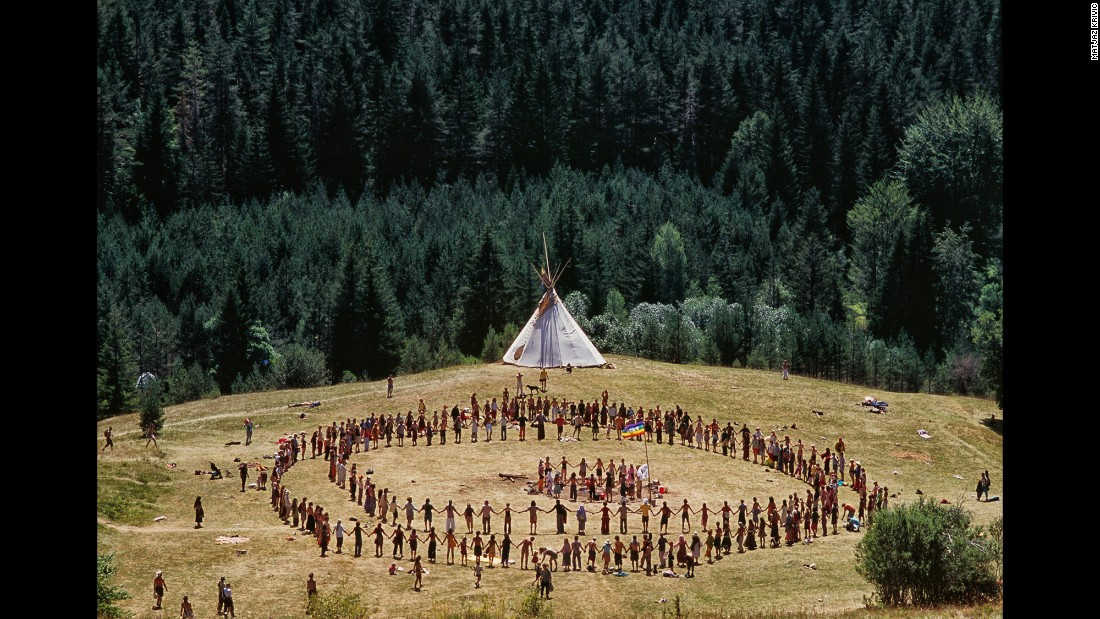 "A ""Rainbow Family"" forms a unity circle at the Bosnia International Rainbow Gathering in 2007."