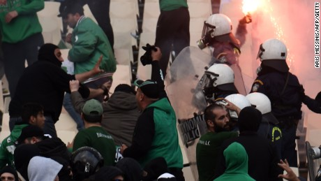 Panathinaikos fans clash with riot police prior to the Greek Cup final last year against PAOK Saloniki.
