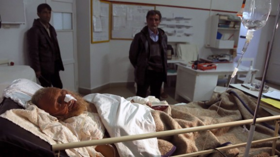 An avalanche survivor lies in a hospital in Panjshir province February 25.