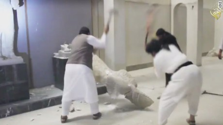 ISIS militants destroy antiquities with sledgehammer