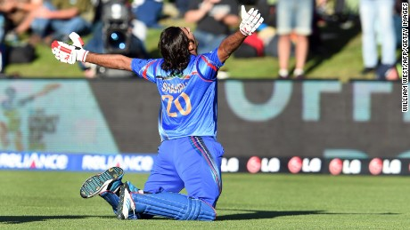 Afghanistan batsman Shapoor Zadran celebrates after hitting the winning runs to defeat Scotland.
