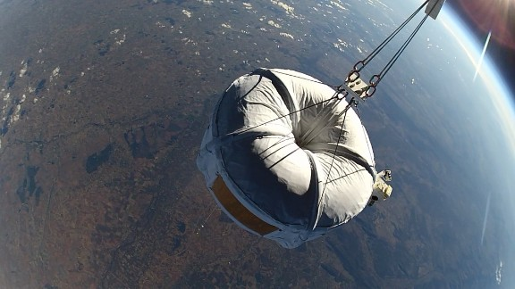 """A """"Micro Bloon"""" spherical capsule on a test flight, far above the Earth."""