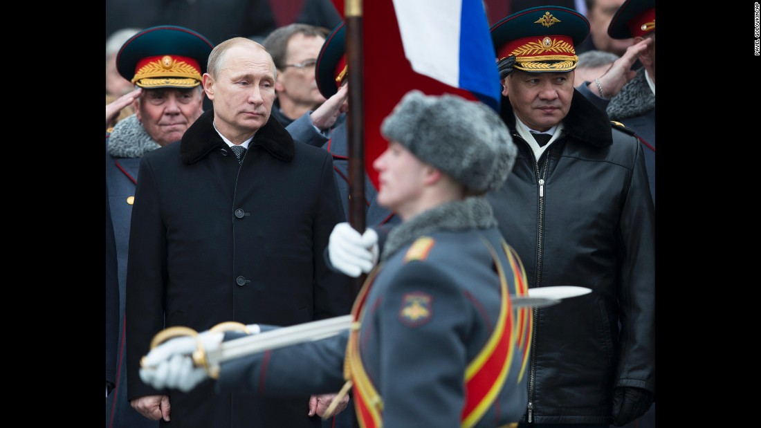 Russian President Vladimir Putin, left, and Defense Minister Sergey Shoigu attend a wreath-laying ceremony at the Tomb of the Unknown Soldier in Moscow, on Monday, February 23.
