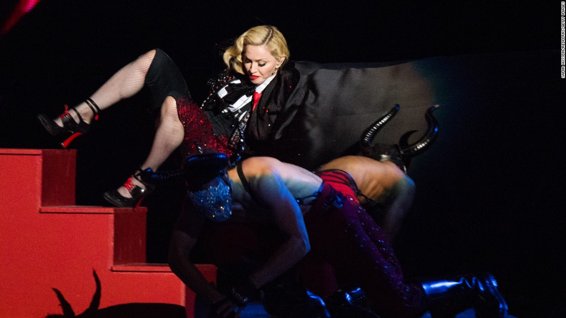 "Singer Madonna falls as she performs ""Living for Love"" at the Brit Awards in London on Wednesday, February 25."