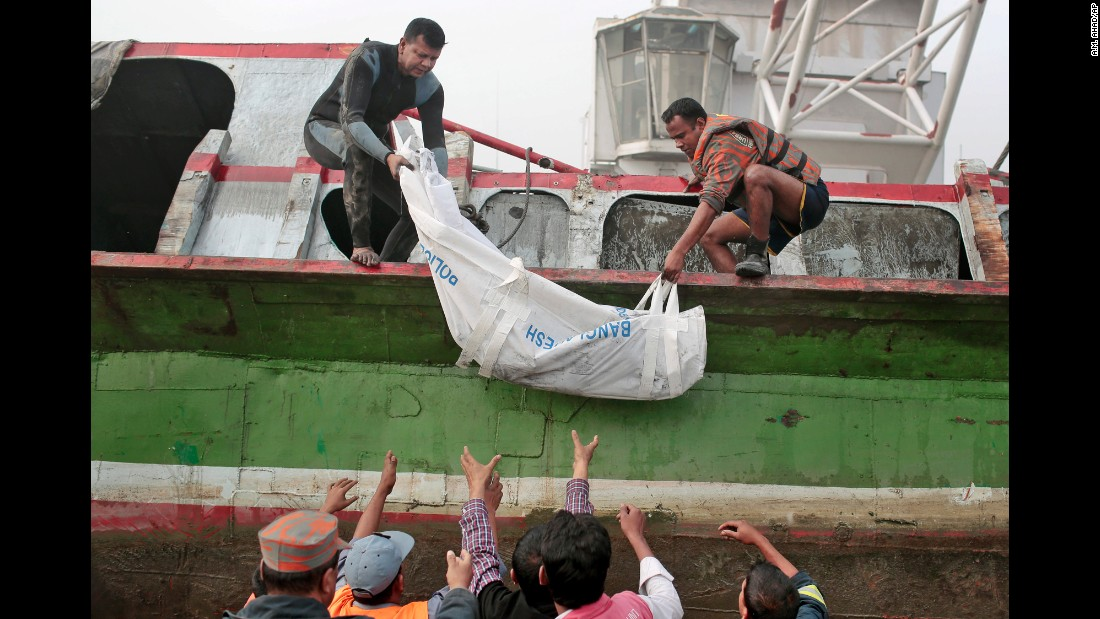 "Bangladeshi rescue workers lift a body after a ferry accident near Dhaka, Bangaldesh, on Monday, February 23. <a href=""http://www.cnn.com/2015/02/22/asia/bangladesh-ferry-accident/"">A double-decker ferry sank</a> after it was hit by a cargo vessel around midday February 22, police and witnesses said."