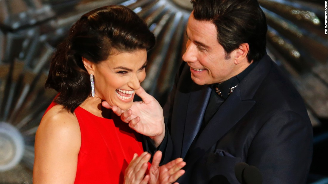 "John Travolta and Idina Menzel present an Oscar together, <a href=""http://www.cnn.com/2014/03/04/showbiz/john-travolta-idina-menzel-oscars/index.html"">referencing last year's flub</a> when he mispronounced her name."