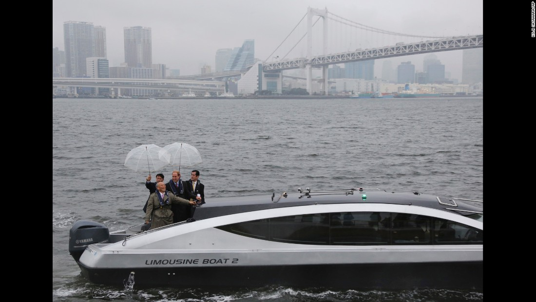 Britain's Prince William, second from right, chats with Tokyo Gov. Yoichi Masuzoe, on a boat in Tokyo harbor near the Rainbow Bridge on Thursday, February 26. William is on a four-day visit to Japan.