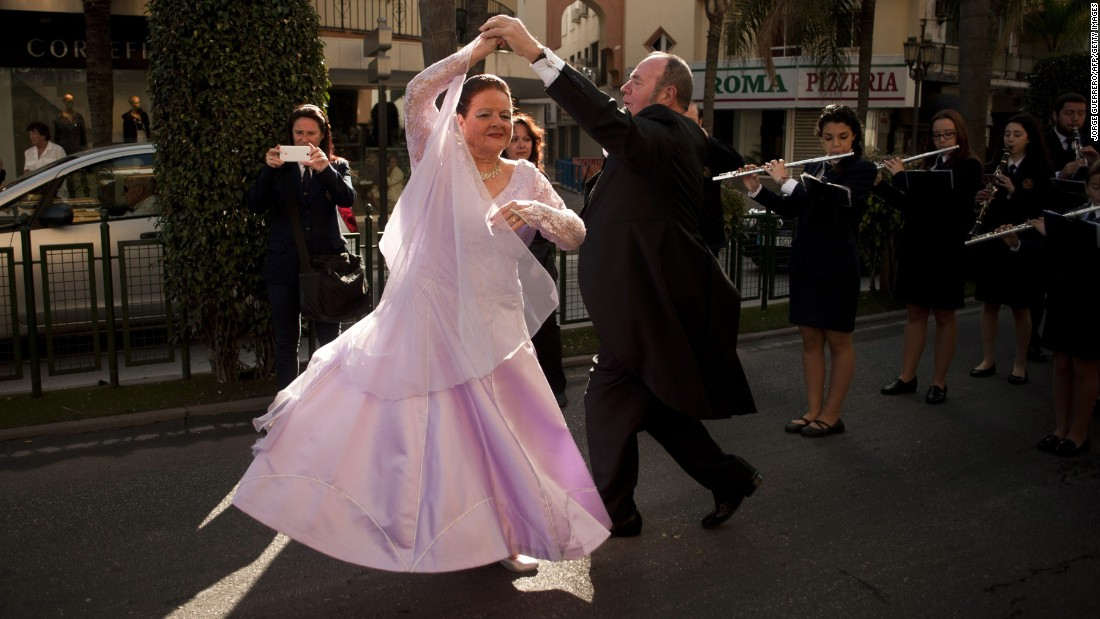 People dance during the street parade in Torremolinos, Spain, launching the European Ballroom Dancing Championships on Monday, February 23.