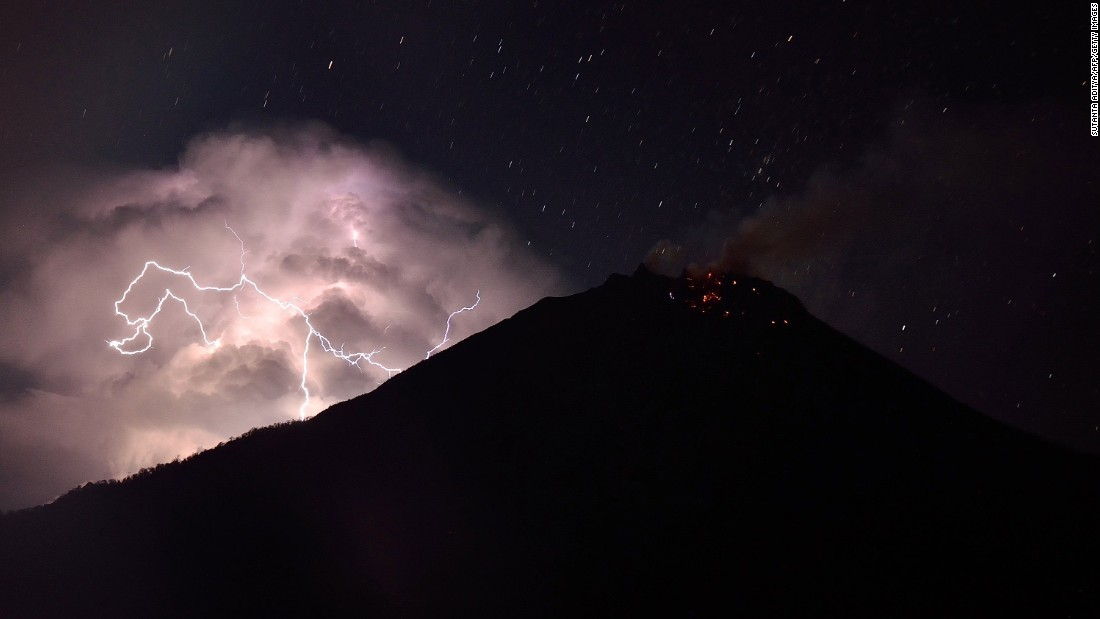 This photo, taken with a long exposure, shows lightning near Mount Sinabung volcano, glowing with lava, as seen from Karo district on Sumatra island in Indonesia on Saturday, February 21.