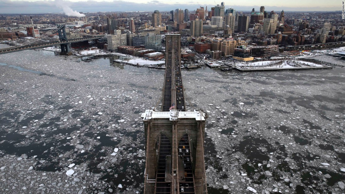 Ice surrounds the Brooklyn Bridge in New York on Tuesday, February 24.