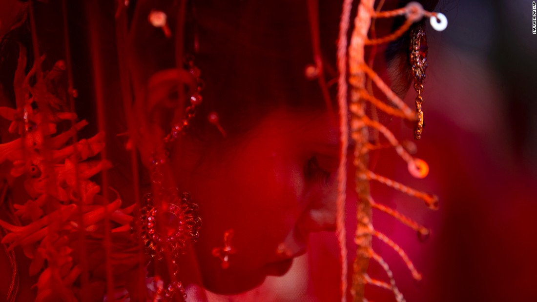 An Indian bride waits for her groom to arrive during a mass marriage ceremony in New Delhi on Friday, February 20. Twelve couples tied the knot in a single ceremony.